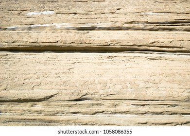 Layers of clay-sandy rock formed by weathering