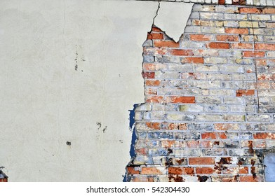 Layers of a Deteriorating Wall - Cement and Orange and White Bricks