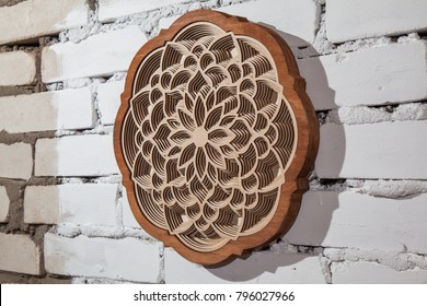 The layers of the mandala are cut from a tree by a laser