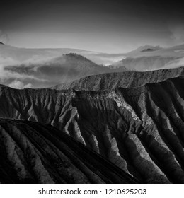 Layers of mountain ( soft , grain effect). Breathtaking view of Volcanos at Bromo, consisting of Active Bromo, Mount Batok and Mount Semeru. black and white photography