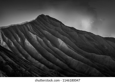 Layers of mountain ( soft , grain and vintage effect). Breathtaking view of Volcanos at Bromo, consisting of Active Bromo, Mount Batok and Mount Semeru. black and white photography