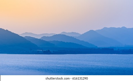 The layers of mountains background. Abstract nature background. the mountains and sunlight lakeside.