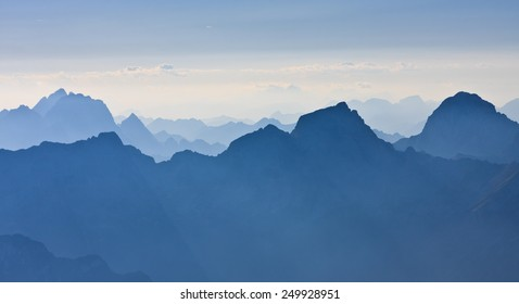 Layers of mountains of Julian Alps in the morning viewed from Kanin mountain, Slovenia