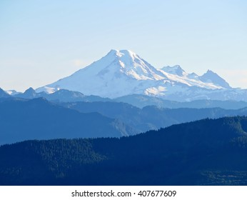 Layers of Mountains, Snow Cappped.  Mount Baker summit, Washington, USA..
