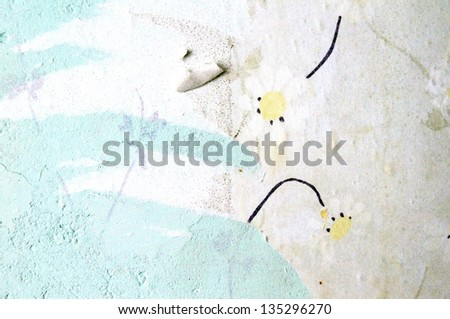 Layers of the old torn wallpaper in a room
