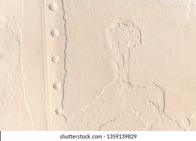 layers of old white varnish at metal surface