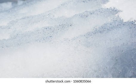 Layers of snow and ice at extreme closeup at winter outdoors