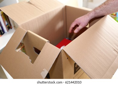 Laying books into a moving box