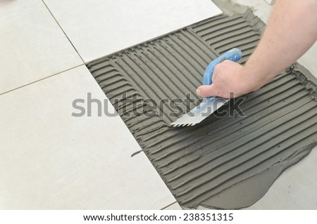 Laying Ceramic Tiles Troweling Mortar Onto Stock Photo Edit Now