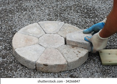 Laying decorative pavers in a circular pattern