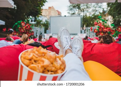 laying eating snacks watching movie at open air cinema