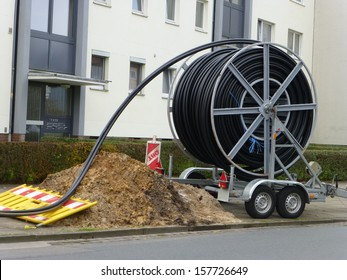 Laying of fiber optic cable in Hanover, Germany.  Glass fibers are employed as fiber optic cable for data transmission and for flexible transport of light.