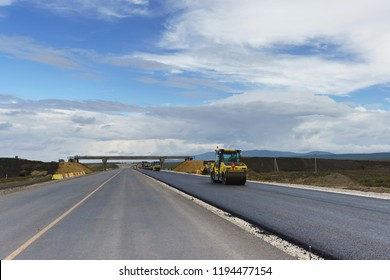 Laying the final layer of asphalt in the construction of a new road in the Crimea. Intersections are equipped with safe bridge crossings. The new highway will be fast and safe