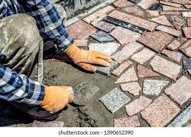 Laying granite tiles on the street
