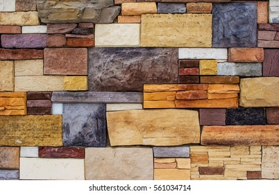 Laying. Masonry of stones of different colors and shapes.Can be used as background and example of texture