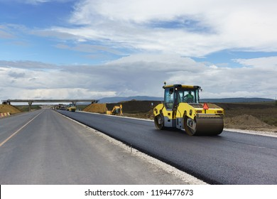Laying the next layer of asphalt in the construction of a new road Tavrida in the Crimea. The crossing of roads is equipped with safe bridge crossings. Special machinery