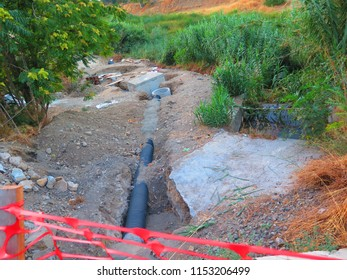 Laying plastic waste water pipes in rural Andalusia to comply with environmental demands from Brussels