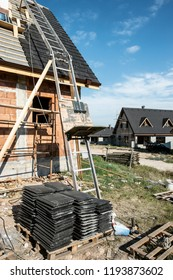 Laying roof tiles on new build house