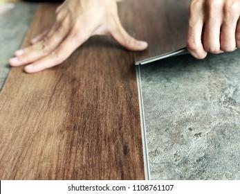 Laying vinyl wood tile on cement floor : DIY renovation concept