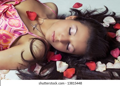 laying woman with rose petals