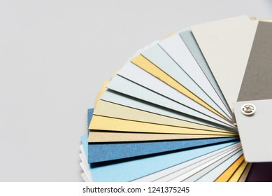 Layout of color paper samples of metallic shades on white background in focus and out of focus