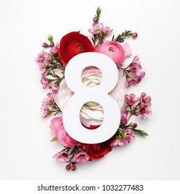 Layout with colorful flowers, leaves and number eight. Flat lay. Top view.