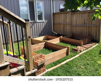 Layout and construction of raised beds for a suburban vegetable garden. Concept of do it yourself projects.