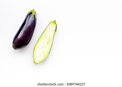 Layout of fresh sliced eggplant on white background top view copy space