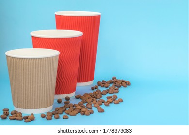 Layout for logos. Coffee cups of different colors on a blue background. Design template. Disposable tableware for hot drinks.