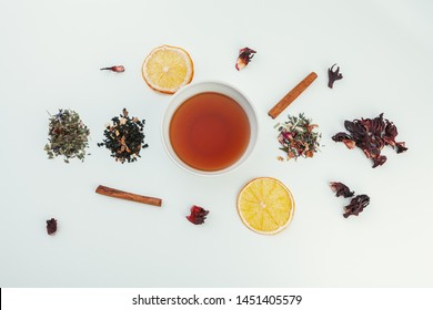 layout made of cup of black tea and leaves on a white background. Top view