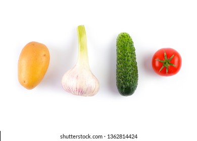 Layout made of potato, garlic, tomato and cucumber on the white background. Flat lay.
