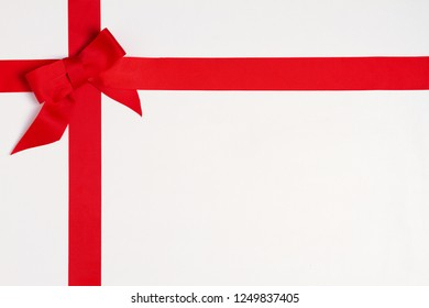 Layout made of red ribbon bow on white background. Mockup, flat lay