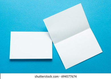A layout for menus or brochures on a blue background. Two sheet brochures or greeting cards. Mock-up.