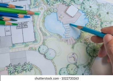 layout plan of home landscape design or garden design drawing by hand with color pencil on white paper and group of color pencils
