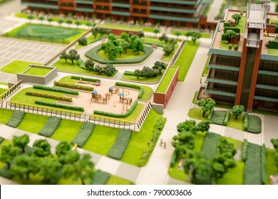 Layout of urban environment with green park, playground and houses