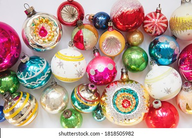 layout of vintage christmas baubles on a plain white background