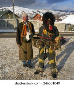 Lazeyschina, Carpathian Mountains, Ukraine-January 9, 2015: Traditional folk gulyaniya- young people dress up in evil spirits and harass passers-by, this tradition is very ancient and picturesque