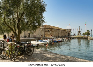 LAZISE, LAKE GARDA, ITALY - SEPTEMBER 2018: Harbour and lakeside buildings at lazise on Lake Garda.