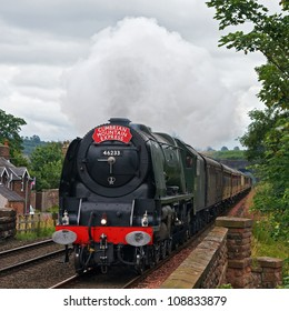 LAZONBY, ENGLAND - JULY 28: Preserved steam locomotive 46233, Duchess of Sutherland, heads the Cumbrian Mountain Express into Lazonby station on July 28, 2012, on the Settle to Carlisle railway.