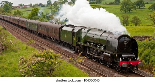 LAZONBY, ENGLAND - JUNE 2: Preserved steam locomotive 46233 Duchess of Sutherland heads the Hadrian through Lazonby on June 2, 2012, on the Settle to Carlisle railway.