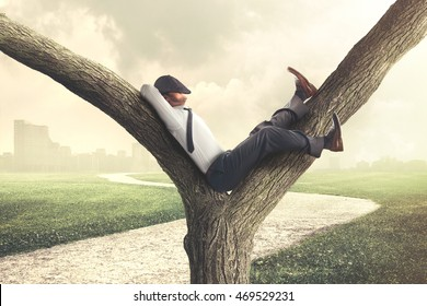 Lazy business man enjoying break on a tree