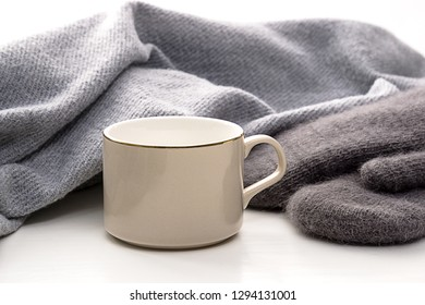 Lazy corner with gray scarf and brown gloves on the windowsill