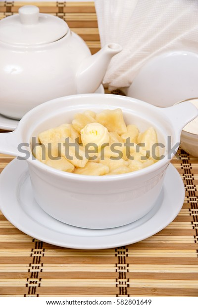 lazy dumplings with butter on a white plate with sour cream and jam with filing for tea