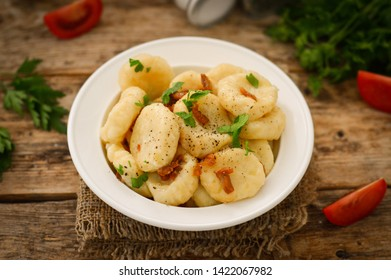 Lazy dumplings in a plate on a wooden background