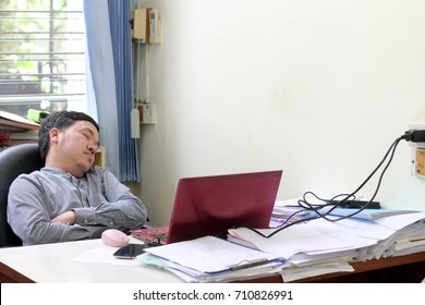 lazy office man sleep in workplace , Asian man in office