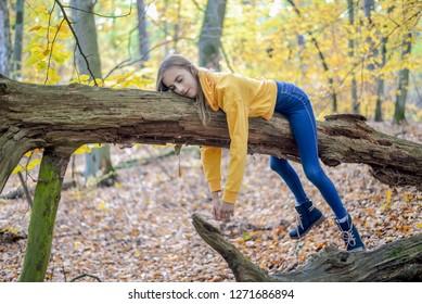 lazy teenager lying on tree