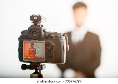 LCD display screen in studio,photograper worker with model businessman