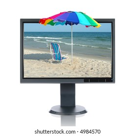 LCD monitor and beach isolated over a white background