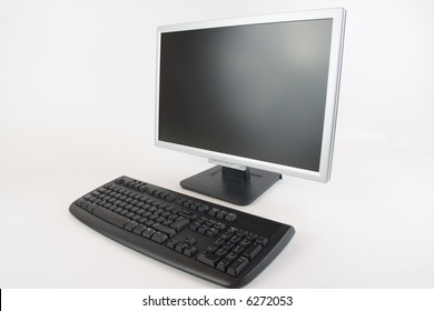 An lcd monitor and keyboard at a 45 degree angle