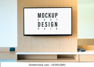 LCD TV mockup in living room. Large Widescreen LCD TV display panel on wood wall for your advertisement artwork. Mock up LCD, OLED, Plastma TV in Bedroom.